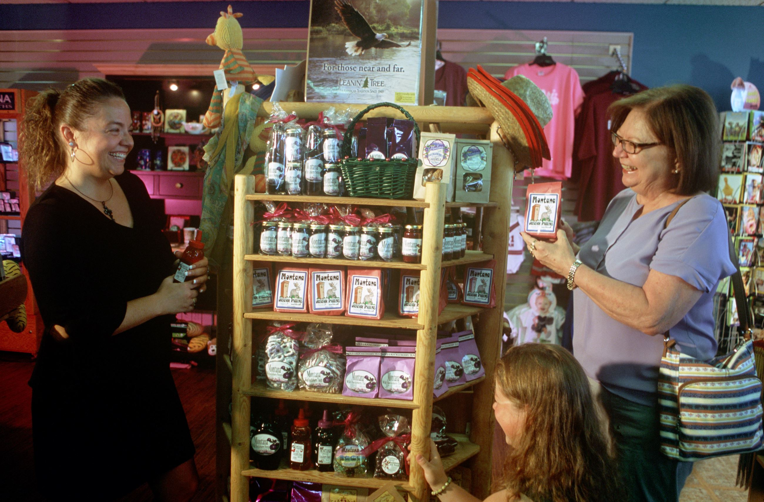 Gift shop 2 - customers looking at a display in gift shop